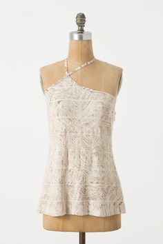 A nice subtle twist on the halter. I really like the pattern of the fabric paired with the intricate stitching.