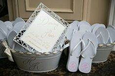 Dancing Shoes Sign & Sandal Favors   Photography: Brett Matthews Photography. Read More:  http://www.insideweddings.com/weddings/regal-outdoor-ceremony-ballroom-reception-at-oheka-castle-in-ny/821/