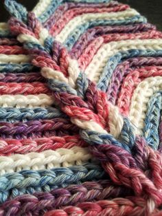 ::Rolling Ridge Blanket Crochet Pattern::- link sends you to buy pattern. But, someone was nice enough to explain it in comments - The large ridge is made by chaining sts and then looping them up whrn done--the ridges on each row are done by crocheting into the back loop of the stitch---is a ripple