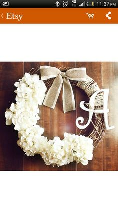 Love this wreath--with yellow chevron and burlap bow, wrapped twine, white hydrangeas and letter. :)
