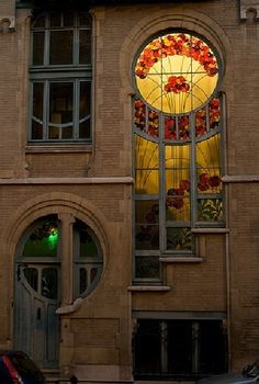 Looking at the night windows of a house and studio in Square Ambiorix on 6 Rue du Lac, Brussels, Belgium - built in 1902 .