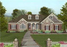"""We've integrated our customer's most requested features into a mid-sized ranch in the creation of this attractive new design. The Craftsman style brick and stone exterior is accented with a """"Palladian"""" window, dormers, multi-level trim and an inviting front porch.   A flexible office/living/4th bedroom, an exquisite master suite, a 3-car garage with a utility sink, and a large screened porch are sure to make this 2000 square foot home irresistible.              The excepti…"""