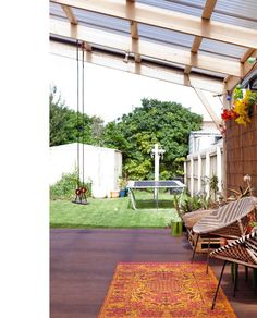 super fun backyard: a swing, a trampoline, and plenty of room for dance parties