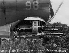 The chin turret of a Boeing B-17G bomber with the cowling removed, revealing its six .50 caliber machine guns (June 17, 1944)