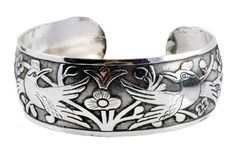 White Metal Birds Tibetan Bracelet Om Tibetan Jewelrys. $14.99. Handmade in Nepal. Birds and Flowers Engraved. Made from Alloy. Fully Adjustable Size. Width: 1.25 Inches