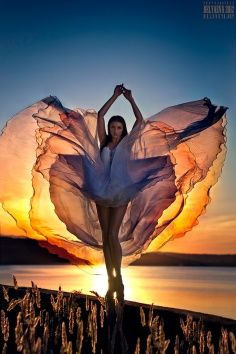 Timing = Perfect; Lighting = Perfect; Shot = Perfect woman, dress, outdoors, sunset, lake, water, backlight backlit photography