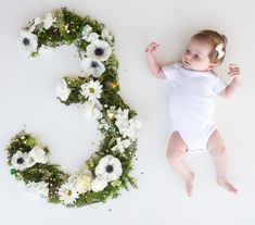 Baby monthly pictures. Fresh flowers. Baby girl. Three months.
