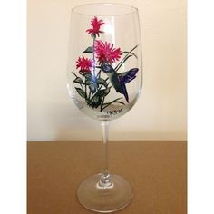 TheHummingbird Wine Glass captures a colorful hummingboard hovering in mid flight among flowers. The 16 ounce hand paintedHummingbird Wine Glass details the beauty of this amazingly tiny bird with i