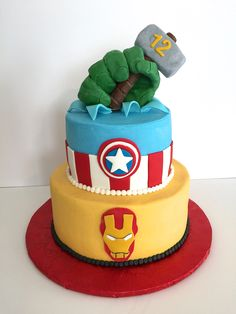 Avenger's cake - buttercream iced cake with fondant details. I molded the hulk hand and Thor's hammer out of modeling chocolate