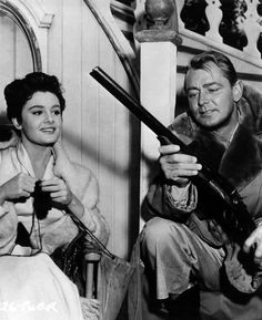 "On the set of ""Santiago"", Rossana Podestá knits, Alan ladd plays with a shotgun."