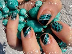 Beautiful manicure in blue-green