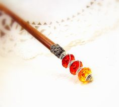 Hair stick accessories beaded accessory tangerine orange obelisk wood Autumn chopstick hair accent wooden pick up do fall colors tagt tenx. $12.95, via Etsy.