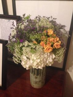 Springtime flowers -  fresh airy arrangement on nightstand table