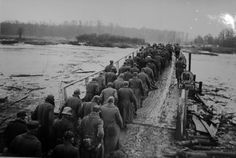 The long march into Soviet captivity begins for this column of German POWs as it crosses the river Oder under guard of troops from the 1st Ukrainian Front. German POWs who survived the ordeal did not see Germany again before the mid 1950s.