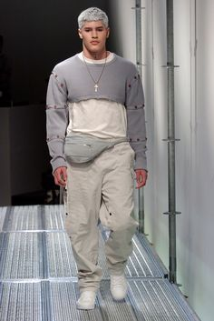 The sartorial-sporty hybrid has changed the shape of menswear. Kim Jones. He's now ensconced at Louis Vuitton, but a decade ago, he was telling extraordinary stories with his own collections. Like this one, a mash-up, he claimed, of a Russian prison camp and the sensual art of Antonio Lopez.  prison-uniform items like sweats and trackpants were elevated in combination with sophisticated tailoring. felt like the Modern Man—this one, at least—might actually want to dress.