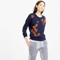 "A cozy sweatshirt plus sequined flowers. Because even the easiest pieces deserve a bit of sparkle. <ul><li>Slightly loose fit.</li><li>Body length: 23 3/4"".</li><li>Cotton.</li><li>Machine wash.</li><li>Import.</li></ul>"