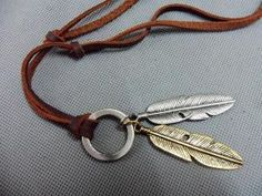 Brown real Leather and alloy feather pendant by sevenvsxiao