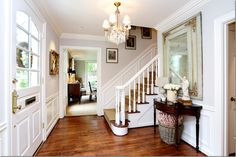 Huh - have been seeing ebonized stair banisters everywhere lately but this is my first white one! No conflict with the hardwood floor color here. From Cote de Texas blog; Houston home for sale.