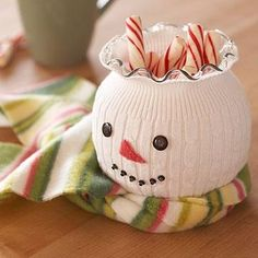 Stretch a sock or sweater sleeve over a small vase and fill with candy canes~~