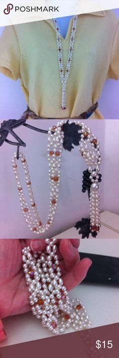 Elegant pearl and faceted stone vintage necklace Loops of pears and orange glass crystals. It has a tied look in front with tassel . No flaws. 19 inches long Vintage Jewelry Necklaces