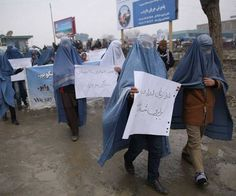 These are men women can love and respect. A group of Afghan men have marched through the capital Kabul in burkas to draw attention to women's rights.