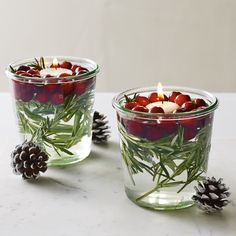 Elegance doesn't have to be complicated or expensive. Fill glass jars with water, rosemary, and cranberries with a floating tea light for a holiday touch that's sure to impress!