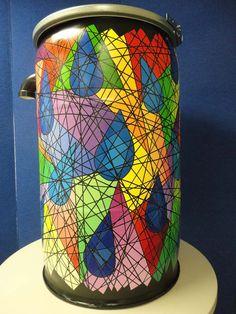 Rain barrel painting inspiration rain barrel yard art for Spray paint plastic trash can