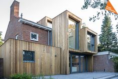 Image 5 of 17 from gallery of Extension of a Post-War House / Lab-S + Kraal Architecten. Photograph by Ed van Rijswijk Wood Cladding Exterior, House Cladding, Timber Cladding, Semi Detached, Detached House, Fasade House, Modern Wooden House, House Extensions, Facade Architecture