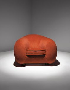 Polar Bear Chair by Jean Royere - photo from chairblog  (9/11/14);  This odd chair sold at the 2014 Phillips design auction for $233,000!!!   (So many better things to spend that much money on ... like food for the homeless.)