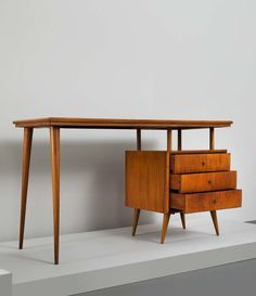 Paul McCobb; Rosewood and Brass 'Bossa Nova' Desk, 1960s.