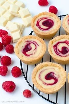 White chocolate and raspberry swirl tartlets (A Sweet Muddle). The sweet tartness of raspberries combined with rich, creamy white chocolate makes it pretty irresistible.