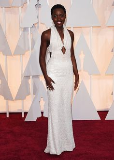 Lupita Nyong'o in a Calvin Klein pearl ivory gown at the 2015 Oscars
