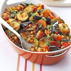 Roast Summer Vegetables & Chickpeas Recipe Main Course with zucchini, eggplant, garlic cloves, red pepper, baking potatoes, onion, coriander seeds, olive oil, chopped tomatoes, garbanzo, coriander