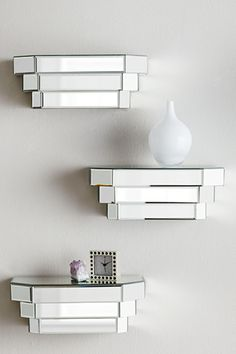 Small mirrored shelves from Horchow.  Accent pieces for hallway to compliment mirrored console.