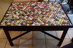 Beer Bottle Cap Table!!!!! I made one of these with some stupid skank face midget WHORE like 6 years ago but never finished it! Im working on my own now! Thanks! :)