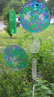 Melted bead suncatchers.  Put cheap plastic beads in a thin layer in a pan. Bake 400 degrees for about 20 min. When cool just invert, fall right out.