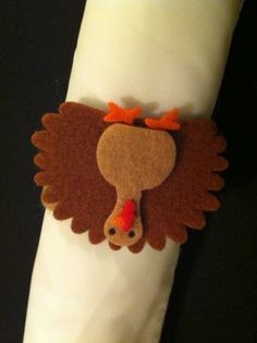 Cute little felt turkeys.  Wonder if I could get someone to cut these out for me?