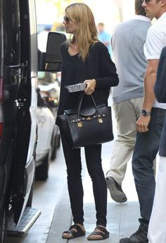 Heidi Klum wearing Birkenstock Arizona sandals Versace Spring Signature Leather Shoulder bag. Heidi Klum Santa Monica June 5 2014.