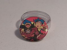 """Comic Book 1.5"""" Button// Wolverine and Jubilee, $1.00"""