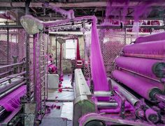 """PhotographerChris Payneexplores American textile factories,home to some colorfully-huedyarns and fabric. As part of his latest series,Textiles, the architect-turned-photographervisited several American textile factories to showcase colorful yarn intertwining with hyper-organized machinery. It's easy to think of the photographs as digitally edited because of the intensepinks, reds, and blues. Payne says, """"I view my work as a celebration of American manufacturing — not a eulogy."""" Check…"""