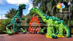 Jurassic World Party decorations. Dinosaurs Balloon sculptures. T-Rex and long neck. Volcano. Party decorations in Miami, FL. Extreme Decorations Ph: 786-663-8198 www.extremedecorations.com extremedecorations@gmail.com