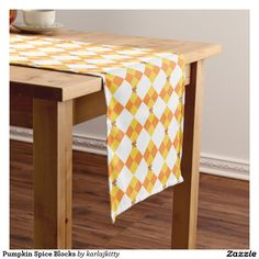 """Pumpkin Spice Blocks Medium Table Runner  Autumn checks in yellow and orange with little fractal blooms on a white background. Click on the """"Customize it!"""" button if you'd like to change the background color, add text, images, etc."""