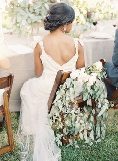 Greenery and Rose Garland on Brides Chair | photography by http://www.ryleehitchnerblog.com/