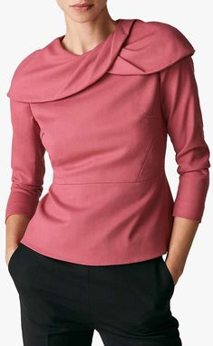 The Fold's Annesley top is tailored from Italian wool crepe in beautiful rose pink. A new shape this season, it features two petal-like details that overlap across the shoulders, finishing at the back zip. The curve of the draping necklines is offset by the nipped-in peplum waist and bracelet length sleeves, creating an ultra-feminine and elegant silhouette. From one of Kate Middletons fave brands. The Fold as seen on Kare Middleton. Fashion over 40. How to wear Pink.