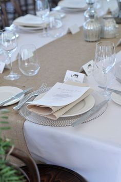 RUSTIC CHIC.  Crisp linens, burlap runners, vintage glass plate chargers and mercury glass vases are styled to create this rustic but chic tables cape. #weddings #YourEventSolution