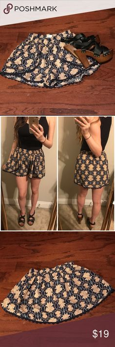 double zero navy and tan damask print skort 〰〰〰〰〰〰〰〰〰 m e a s u r e m e n t s   l: 14 in w: 12 in *laying flat*  〰〰〰〰〰〰〰〰〰 d e s c r i p t i o n  double zero navy and tan damask print layered tulip skort, with lace trim. if you wanna feel flirty and look like royalty look no further. forreal tho, i doubt another garmet will fit that description. hand wash.  shell: 100% polyester   〰〰〰〰〰〰〰〰〰 f l a w s  none  〰〰〰〰〰〰〰〰〰 t a g s  double zero skort playful flirty new printed spring summer trendy…
