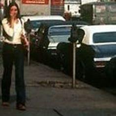 October, 1970 Manhattan sidewalk scene, N.Y. City, N.Y. with female pedestrian walking