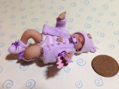 dolls house ooak baby girl with rattle lilac by Sarahsooakbabies