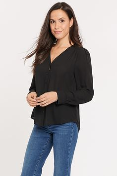 The Smocked V-Neck Blouse by NYDJ has a sophisticated long-sleeved silhouette that dresses up any pair of jeans. Front shoulder gathers and smocking along the back yoke add detail and create soft drape. A full front placket with button closures and button cuffs finish the look. | NYDJ Women's Smocked V-Neck Blouse in Jet Black, Regular, Size: XS V Neck Blouse, Cuff Sleeves, Smocking, Jet, Cuffs, Dress Up, Silhouette, Detail, Button