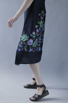 Work in progress: black linen sleeveless dress with floral embroidery pattern. For more information visit us on Facebook https://www.facebook.com/GN_design-1617224841891321